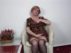 Short-haired mature lady sits down and tries to please herself