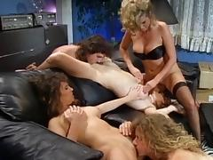 Retro shoot of cowgirl coping with pussy fisting in group sex