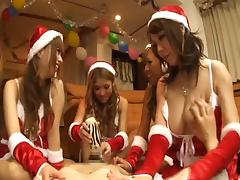 Santa Asian babe masturbating using vibrator in hardcore group sex