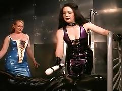 Rubber Mistresses Enclose The Sub