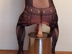 Blonde bitch in bodystocking and High Heels riding a dildo