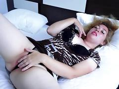 Lusty mature bitch slides her fingers in her juicy pink slit