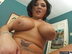 Tattooed dame oiling her big tits then having her shaved pussy fingered