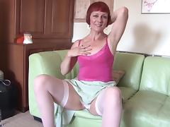 Luscious redhead mature slag enjoys pleasuring her twat with fingers