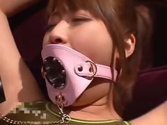 Closeup shoot of Asian dame giving huge dick titjob