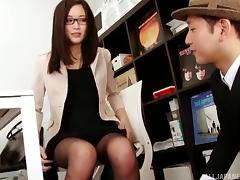 Japanese office worker with glasses giving the best possible handjob