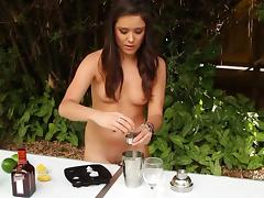 Really cute girl mixing drinks