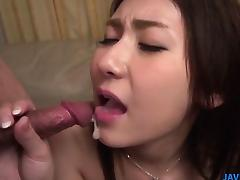 Maya kneels between dicks to suck and swallow