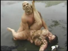 Masked man fucks a BBw in the mud