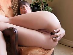 Brunette sugar strikes a pose to start slamming her asshole with a toy