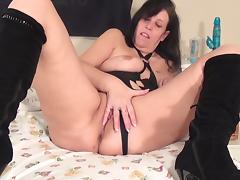 Putting her toy in her mouth and pussy that is now slippery