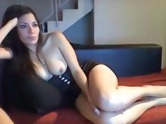 Horny brunette milf showing her big boobies on the webcam