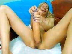Blonde dildo fucks her horny pussy with huge dildo and teases on cam