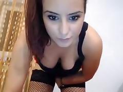 Sexy brunette slut on webcam stripteasing and shows off her nice big tits