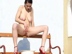 sexy brunette with cool hangers photoshooting piss