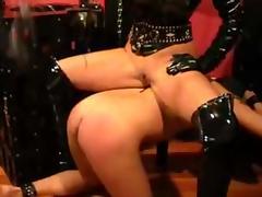 PVC Goddess Flogs her slave