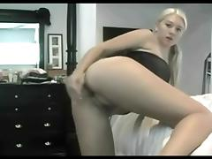 Blonde chick fucks her shaved pussy with a dildo