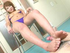 Akiho Nishimura stroking it up and down it with her feet and making it extra hard