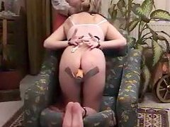 Cuffed hands and feet Freaky chick has her hands and feet cuffed and bends over on the sofa helpless