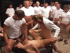 Fifty strong dudes lined up to fuck a busty babe Manuella