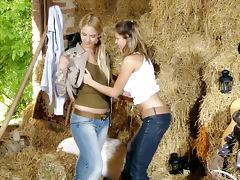 Two pretty girls fingering each other's holes in the stable