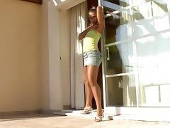 Lewd brown haired slut finger fucking her vagina on the balcony