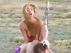 Young lesbians have sex in a field