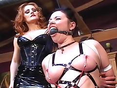 Latex mistress enjoys heavy bondage play