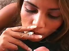 Exotic girl gives smoking blowjob