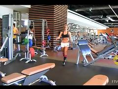 Well shaped sexy babe with big bobs is exersising in the gym and maturbates