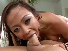 Fake tits Asian deepthroats a cock