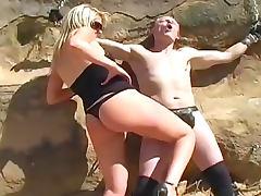 Abusive femdom blonde in the desert