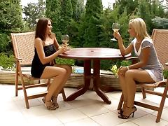 Two lesbian nymphs rub and tug each other's hot pussies