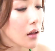 Sassy Emi Orihara in green and white kneels before a horny guy to suck his cock and make him cum