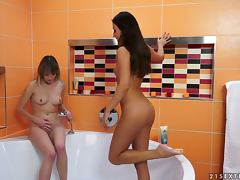 Angel Piaf and Iwia fist each other's pussies in the bathroom