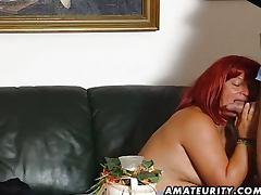 Redhead amateur Milf sucks cock with cumshot