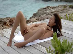 Asian angel masturbating by the ocean