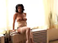 Hot brunette Nancy Erminia boasts of her amazing big boobs