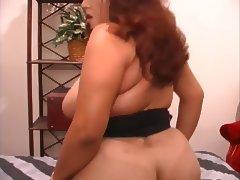 Curvy Latina rides dildo on dresser