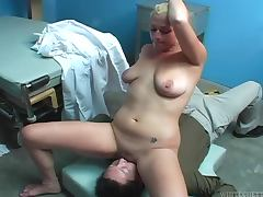 Lacey Jayne the sexy blondie giving a blowjob to a doctor