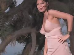 Horny siren Crystal McCahill gets naked on the beach