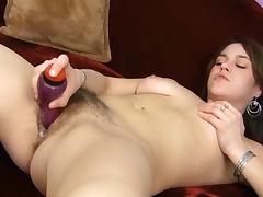 Sensi Savoy fucks her hairy pussy with dildo