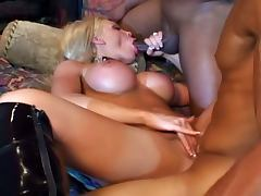 Busty chick nailed by two huge size black dicks