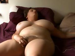 bbw girl with glass masturbates on bed
