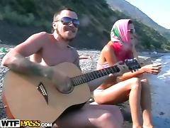 He plays guitar for her and fucks her on the beach