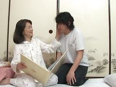 Slutty Japanese MILF gets fingered and then fucked