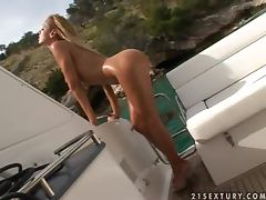 Sandy enjoys playing with her wet pussy on a yacht