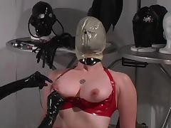 Red latex slave enjoys breath play