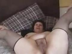 Mature fattie shows off her hairy vagina and fingers it