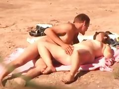 Insatiable wife gets fucked in missionary position on a beach